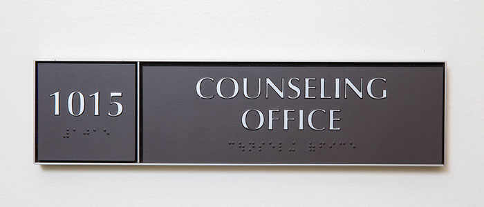 wall plaque with room number 1015 and embossed text reading Counseling Office