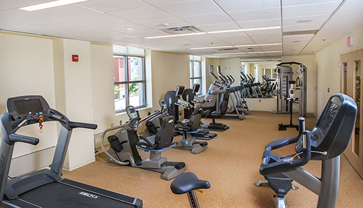 room filled with exercise equipment