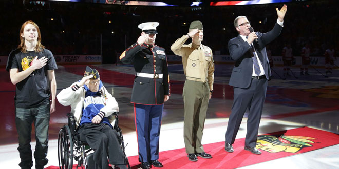 veterans from 20 to 80 years old saluting national anthem