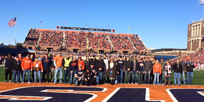 group of 50 vets standing on the goal line of Memorial Stadium before an Illini football game