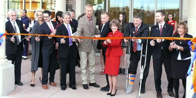 ribbon cutting ceremony with various campus and state officials